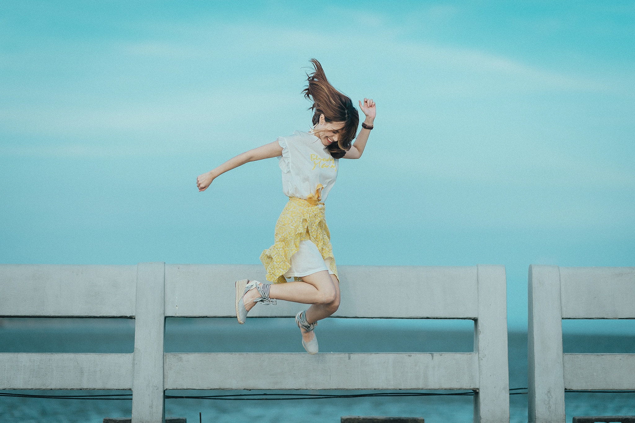 jumpshot-photography-of-woman-in-white-and-yellow-dress-near-884977